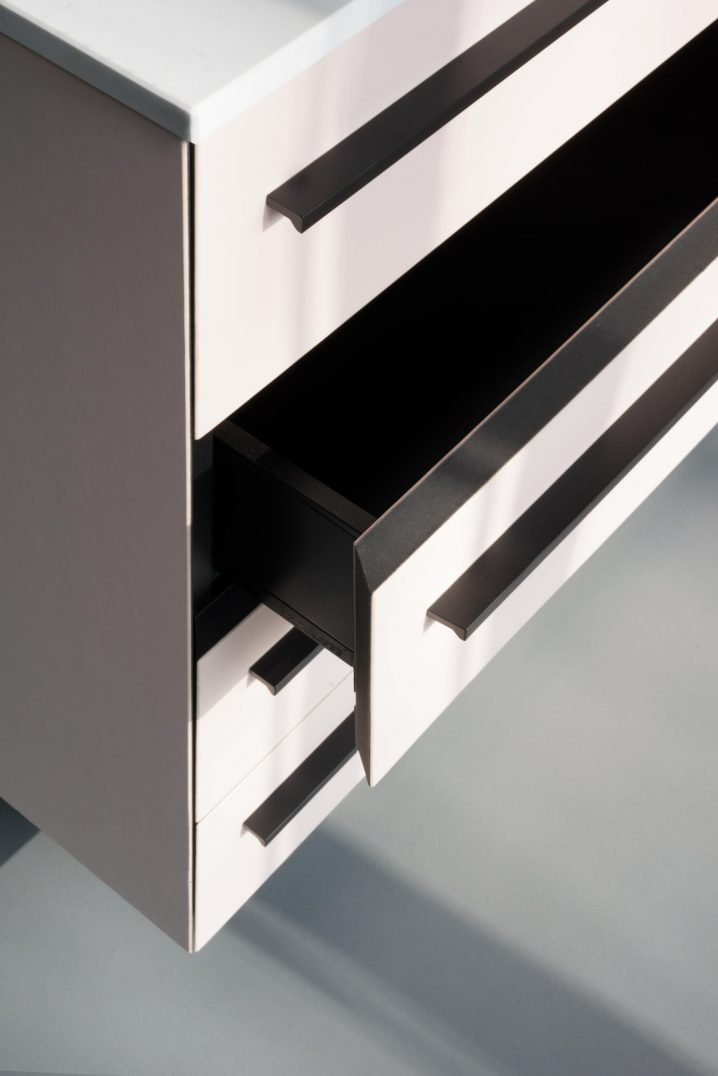 Black cabinet drawers interior with linoleum fronts