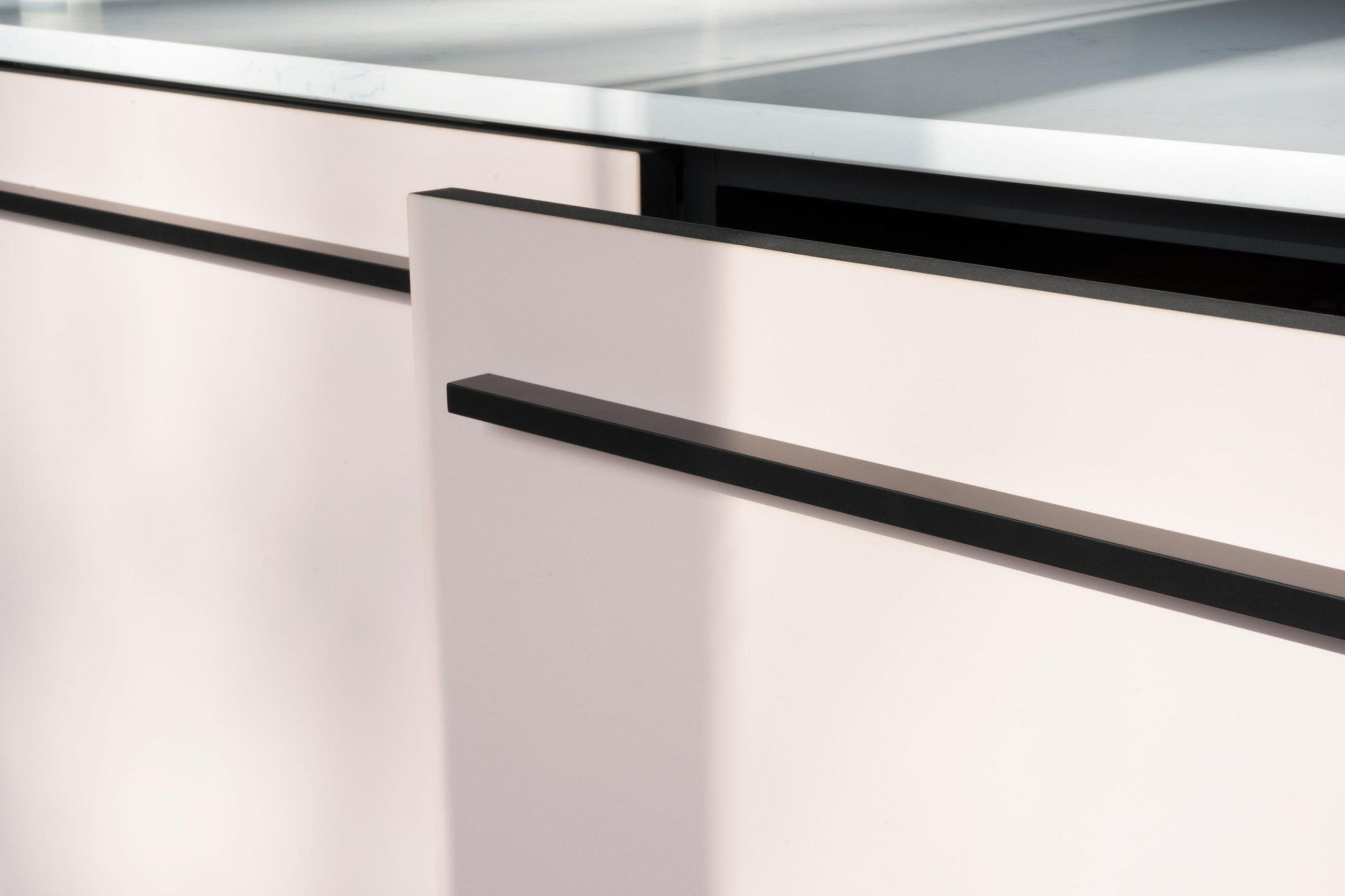 Black thin grips on light pink linoleum fronts