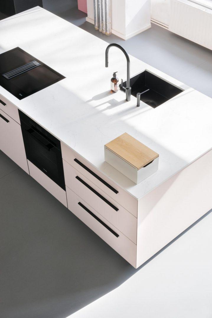 Kitchen island with a white Bread Box  at MYKILOS showroom, Berlin