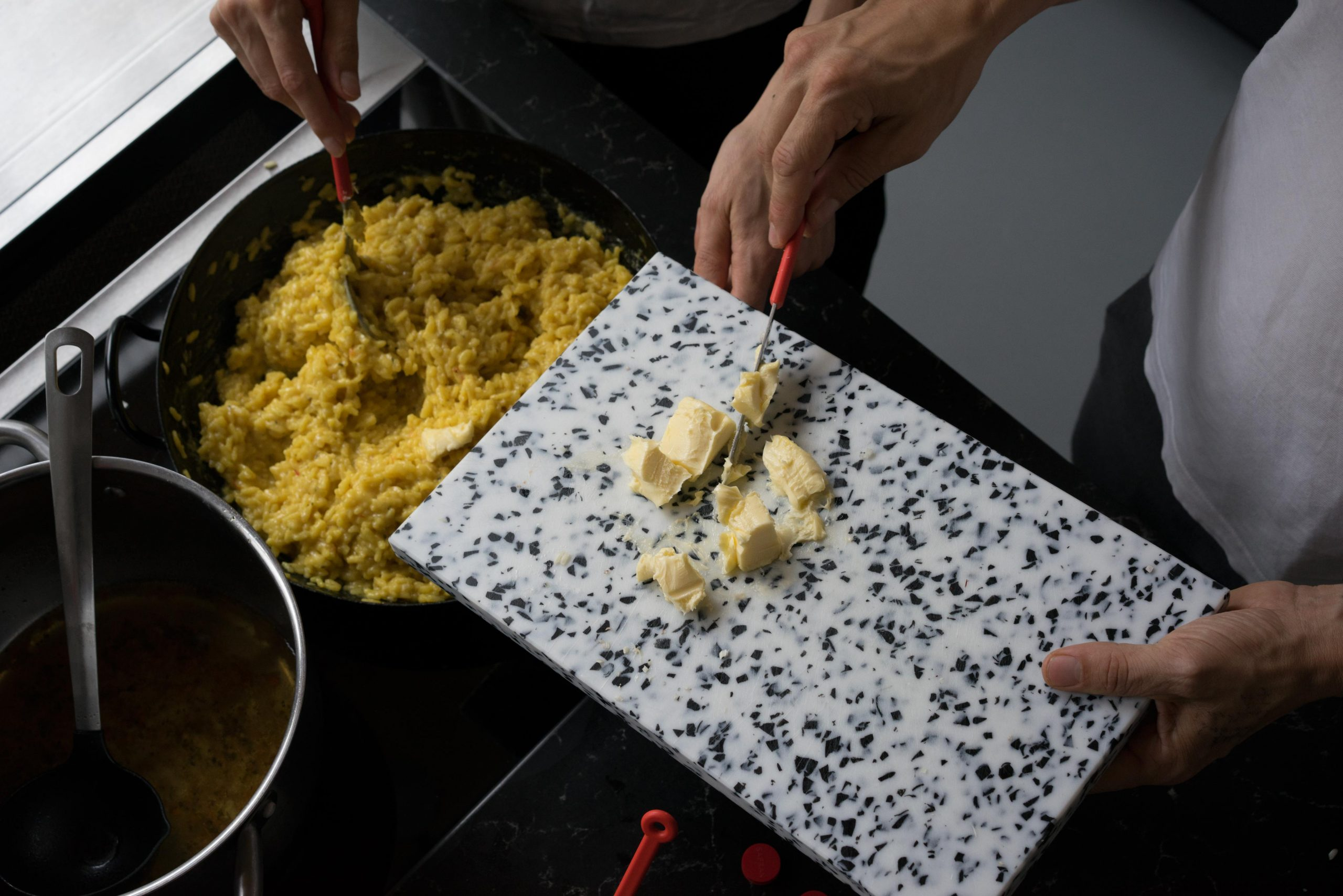Adding butter to the Saffron risotto