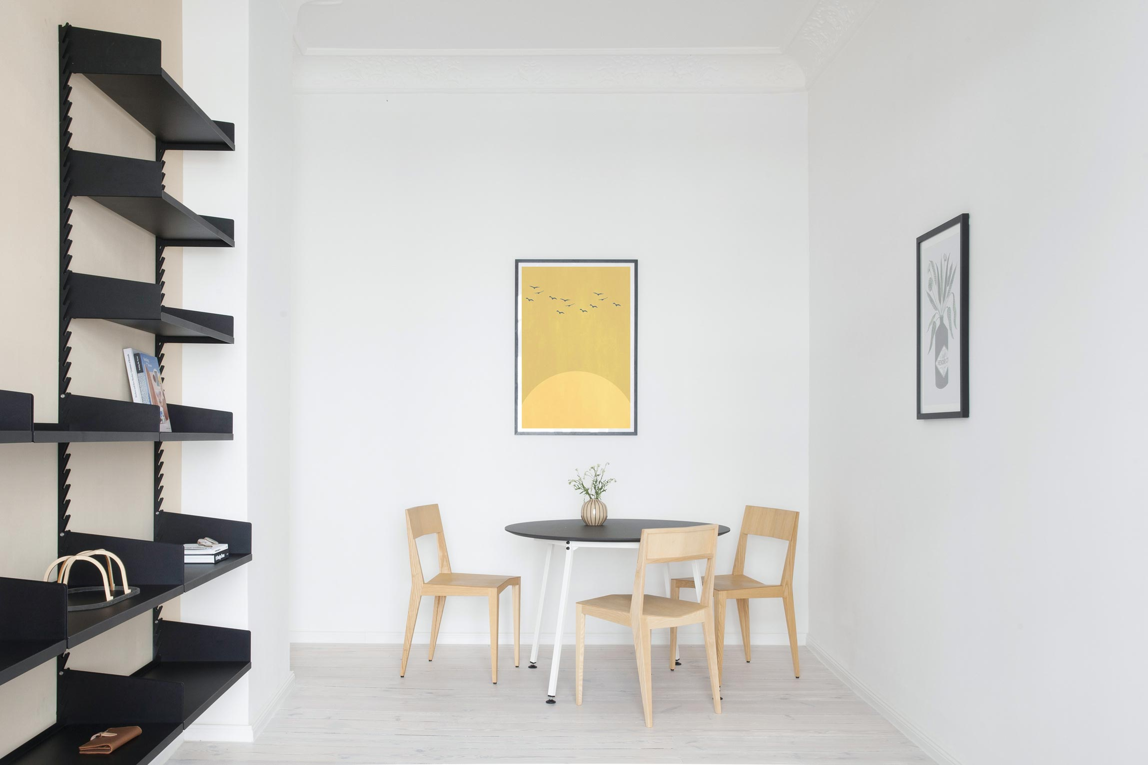 The living rom for Furnished Apartment includes the Even Better Shelf, Easy Round table and Chair 3.