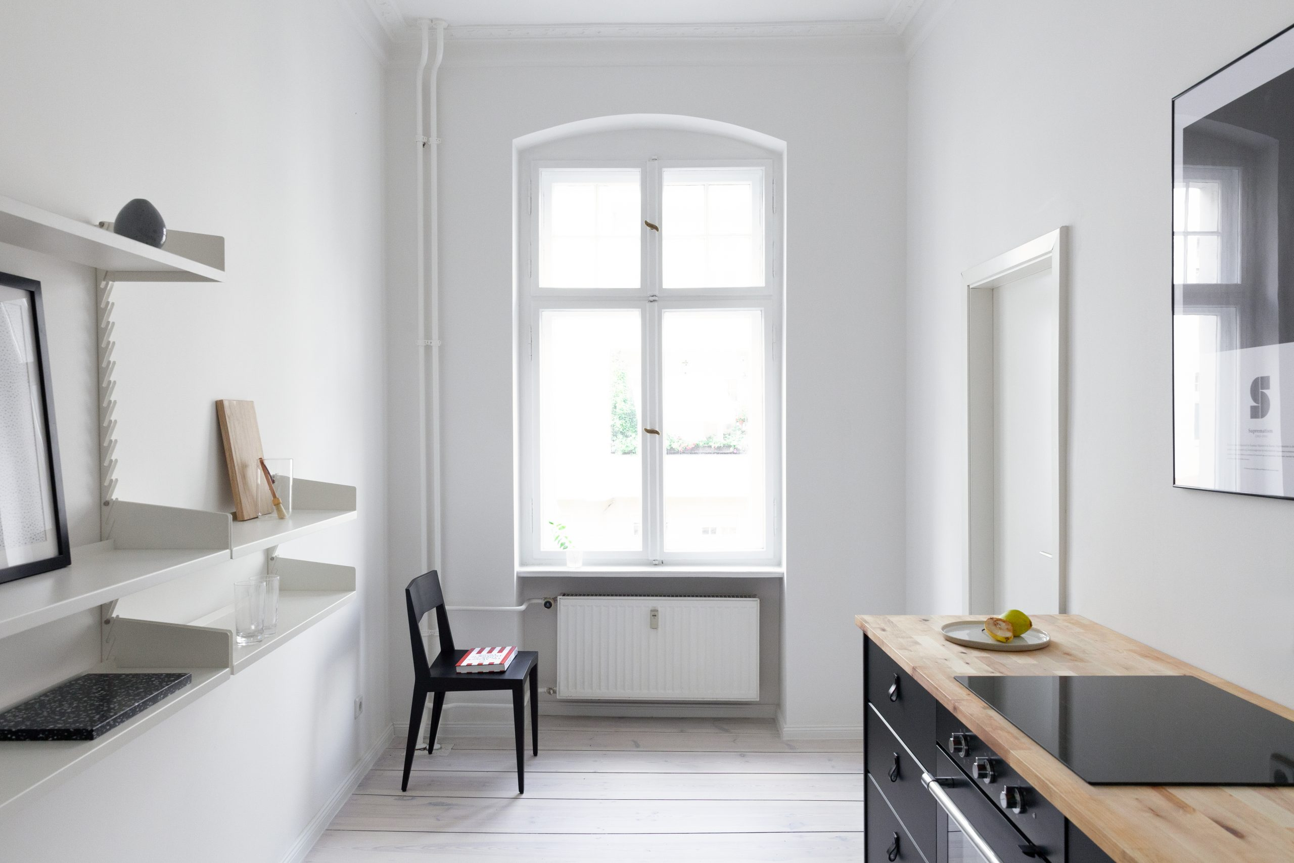 The kitchen room equipped with the Even Better Shelf set 2 + set 1 Extension for ultimate storage - Fantastic Frank Furnished Apartment.