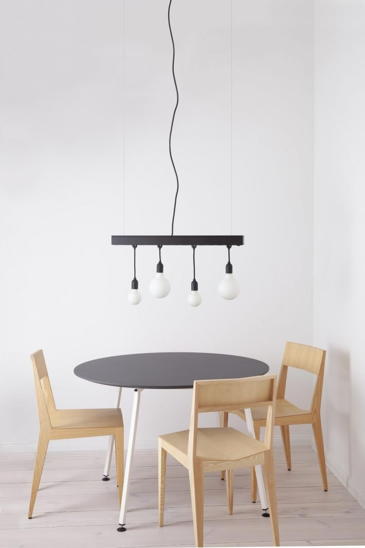 Hang Jack pendant lamp and power bar fitted with LED Porcelain Bulbs above an Easy Round Table and Chair 3